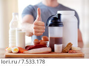 Купить «man with protein food showing thumbs up», фото № 7533178, снято 14 мая 2015 г. (c) Syda Productions / Фотобанк Лори