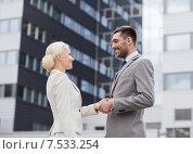 Купить «smiling businessmen standing over office building», фото № 7533254, снято 19 августа 2014 г. (c) Syda Productions / Фотобанк Лори