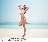 Купить «happy young woman in white bikini swimsuit», фото № 7533370, снято 14 апреля 2015 г. (c) Syda Productions / Фотобанк Лори