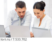 Купить «group of people working with laptops in office», фото № 7533702, снято 9 июня 2013 г. (c) Syda Productions / Фотобанк Лори