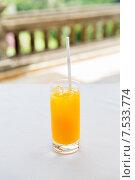 Купить «glass of fresh orange fruit juice at restaurant», фото № 7533774, снято 21 февраля 2015 г. (c) Syda Productions / Фотобанк Лори