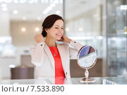 Купить «happy woman choosing pendant at jewelry store», фото № 7533890, снято 30 апреля 2015 г. (c) Syda Productions / Фотобанк Лори