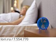 Купить «close up of alarm clock in bedroom», фото № 7554770, снято 23 ноября 2013 г. (c) Syda Productions / Фотобанк Лори