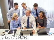 Купить «smiling business people with laptop in office», фото № 7554790, снято 25 октября 2014 г. (c) Syda Productions / Фотобанк Лори