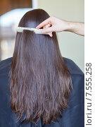 Купить «hand with comb combing woman hair at salon», фото № 7555258, снято 15 февраля 2015 г. (c) Syda Productions / Фотобанк Лори