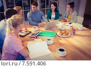 Купить «Group of young colleagues using laptop», фото № 7591406, снято 22 марта 2015 г. (c) Wavebreak Media / Фотобанк Лори