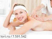 Купить «Pretty blonde enjoying a massage smiling at camera», фото № 7591542, снято 11 февраля 2015 г. (c) Wavebreak Media / Фотобанк Лори