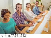 Купить «Smiling call centre team looking at the camera», фото № 7591782, снято 22 марта 2015 г. (c) Wavebreak Media / Фотобанк Лори