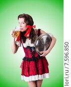Bavarian girl with tray against the gradient. Стоковое фото, фотограф Elnur / Фотобанк Лори
