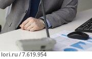 Купить «close up of businessman dialing phone number», видеоролик № 7619954, снято 4 апреля 2015 г. (c) Syda Productions / Фотобанк Лори