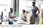 Купить «happy creative team drinking coffee in office», видеоролик № 7623554, снято 2 апреля 2015 г. (c) Syda Productions / Фотобанк Лори