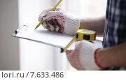 Купить «close up of man with measuring ruler and clipboard», видеоролик № 7633486, снято 28 марта 2015 г. (c) Syda Productions / Фотобанк Лори