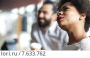 Купить «happy creative team drinking coffee in office», видеоролик № 7633762, снято 2 апреля 2015 г. (c) Syda Productions / Фотобанк Лори