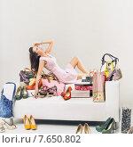 Купить «Relaxing youn woman in the room full of shoping», фото № 7650802, снято 25 марта 2014 г. (c) Ingram Publishing / Фотобанк Лори