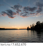 Купить «Silhouette of trees at the lakeside, Lake of The Woods, Ontario, Canada», фото № 7652670, снято 12 августа 2013 г. (c) Ingram Publishing / Фотобанк Лори
