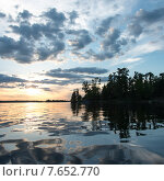 Купить «Reflection of tress and clouds on water, Lake of The Woods, Ontario, Canada», фото № 7652770, снято 8 июня 2013 г. (c) Ingram Publishing / Фотобанк Лори