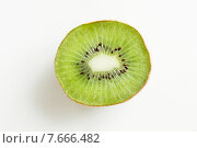 Купить «close up of ripe kiwi slice on table», фото № 7666482, снято 28 апреля 2015 г. (c) Syda Productions / Фотобанк Лори