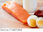 Купить «close up of salmon fillets, eggs and milk on table», фото № 7667054, снято 14 мая 2015 г. (c) Syda Productions / Фотобанк Лори