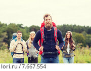 Купить «group of smiling friends with backpacks hiking», фото № 7667554, снято 31 августа 2014 г. (c) Syda Productions / Фотобанк Лори