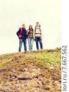 Купить «group of smiling friends with backpacks hiking», фото № 7667562, снято 31 августа 2014 г. (c) Syda Productions / Фотобанк Лори