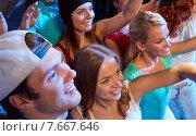 Купить «smiling friends at concert in club», фото № 7667646, снято 20 октября 2014 г. (c) Syda Productions / Фотобанк Лори