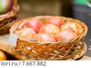 Купить «ripe pomegranates in basket at food market», фото № 7667882, снято 20 декабря 2014 г. (c) Syda Productions / Фотобанк Лори