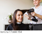 Купить «happy woman with stylist making hairdo at salon», фото № 7668154, снято 15 февраля 2015 г. (c) Syda Productions / Фотобанк Лори