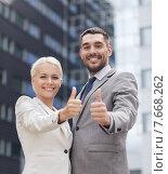 Купить «smiling businessmen showing thumbs up», фото № 7668262, снято 19 августа 2014 г. (c) Syda Productions / Фотобанк Лори