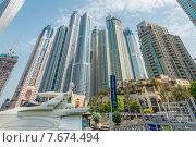 Купить «Dubai - AUGUST 9, 2014: Dubai Marina district on August 9 in UAE. Dubai is fastly developing city in Middle East», фото № 7674494, снято 9 августа 2014 г. (c) Elnur / Фотобанк Лори