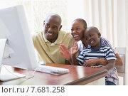 Купить «Happy smiling family chattting with computer», фото № 7681258, снято 6 февраля 2015 г. (c) Wavebreak Media / Фотобанк Лори
