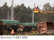 Купить «Hosena, Germany, Eisenbahnunglueck in Brandenburg, workers remove the overhead line», фото № 7681658, снято 27 июля 2012 г. (c) Caro Photoagency / Фотобанк Лори