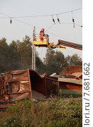 Купить «Hosena, Germany, Eisenbahnunglueck in Brandenburg, workers remove the overhead line», фото № 7681662, снято 27 июля 2012 г. (c) Caro Photoagency / Фотобанк Лори
