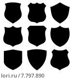 Black custom shields. Стоковая иллюстрация, иллюстратор Michael Travers / Фотобанк Лори