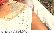 Купить «Молодой мужчина и женщина пишут романтические письма», видеоролик № 7984610, снято 18 июня 2015 г. (c) Tatiana Kravchenko / Фотобанк Лори
