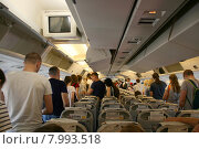"""Купить «Самолет """"Боинг 767-300"""" приземлился, пассажиры в салоне направляются к выходу. Авиакомпания """"Катэкавиа"""" (Azur Air)», эксклюзивное фото № 7993518, снято 6 июля 2015 г. (c) Щеголева Ольга / Фотобанк Лори"""