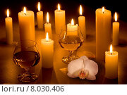 Romantic table with candles and orchid. Стоковое фото, фотограф Pavel Seplavy / PantherMedia / Фотобанк Лори