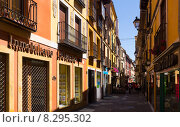 Купить «Old narrow street with stores in Leon», фото № 8295302, снято 27 июня 2015 г. (c) Яков Филимонов / Фотобанк Лори