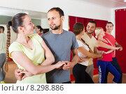Купить «Adults dancing in dance studio», фото № 8298886, снято 21 сентября 2018 г. (c) Яков Филимонов / Фотобанк Лори