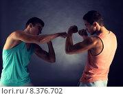 Купить «young men wrestling», фото № 8376702, снято 22 сентября 2014 г. (c) Syda Productions / Фотобанк Лори