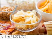 Купить «close up of crunchy potato crisps in glass bowl», фото № 8378774, снято 21 мая 2015 г. (c) Syda Productions / Фотобанк Лори