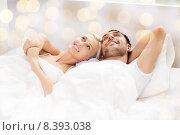 Купить «happy couple lying in bed at home», фото № 8393038, снято 6 июня 2015 г. (c) Syda Productions / Фотобанк Лори