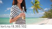 Купить «close up of smiling young woman drinking on beach», фото № 8393102, снято 13 июля 2014 г. (c) Syda Productions / Фотобанк Лори