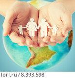 Купить «human hands holding paper family over earth globe», фото № 8393598, снято 28 марта 2013 г. (c) Syda Productions / Фотобанк Лори