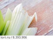 Купить «close up of celery stems on table», фото № 8393906, снято 17 марта 2015 г. (c) Syda Productions / Фотобанк Лори
