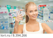 Купить «young woman with pills in drugstore or pharmacy», фото № 8394266, снято 23 марта 2013 г. (c) Syda Productions / Фотобанк Лори