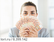 Купить «woman hiding her face behind euro money fan», фото № 8399142, снято 2 июля 2015 г. (c) Syda Productions / Фотобанк Лори