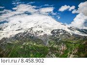 Купить «Гора Эльбрус с вершиной в облаках. Вид с высоты 3000 м горы Чегет. Кабардино-Балкария, Россия», фото № 8458902, снято 5 июля 2015 г. (c) katalinks / Фотобанк Лори