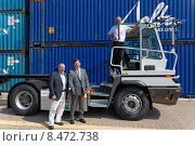 Berlin, Germany, Herbert Sonntag, Peter Stäblein and Carsten Giese at an electric truck (2014 год). Редакционное фото, агентство Caro Photoagency / Фотобанк Лори