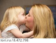 Купить «Мама целует ребенка», фото № 8472798, снято 30 декабря 2014 г. (c) Олег Хархан / Фотобанк Лори