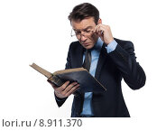 Купить «Man professor reading», фото № 8911370, снято 27 марта 2019 г. (c) PantherMedia / Фотобанк Лори